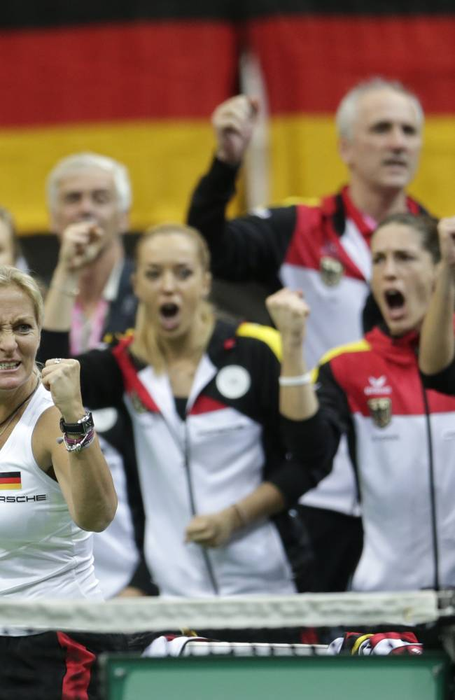 Germany's captain Barbara Rittner and her team react during the Fed Cup Final tennis match between Czech Republic's Petra Kvitova and Germany's Angelique Kerber in Prague, Czech Republic, Sunday, Nov. 9, 2014