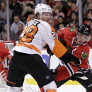 Philadelphia Flyers center Claude Giroux (28) keeps Chicago Blackhawks center Jonathan Toews away from the puck after a face off during the first period of an NHL hockey game Tuesday, Oct. 21, 2014, in Chicago The Associated Press