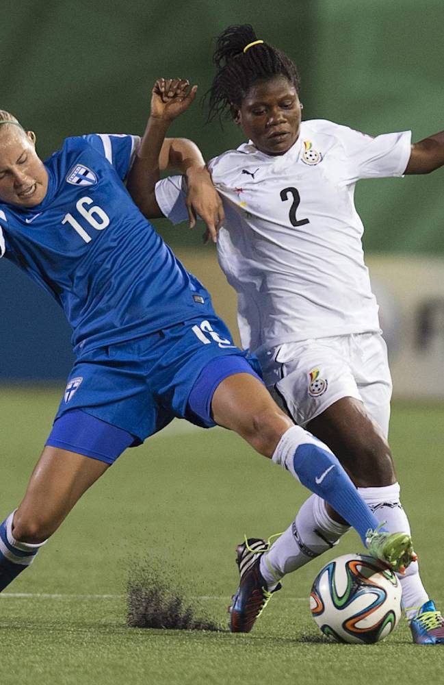 Finland's Ria Oling and Ghana's Rebecca Asante battle for the ball at the FIFA U20 Women's World Cup in Moncton, New Brunswick, on Tuesday, Aug. 12, 2014. Ghana won 2-1