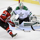 Dallas Stars goaltender Kari Lehtonen (32), of Finland, makes a save on a shot by New Jersey Devils' Adam Henrique (14) during the third period of an NHL hockey game Friday, Oct. 24, 2014, in Newark, N.J. The Stars won in a shootout 3-2 The Associated Pre