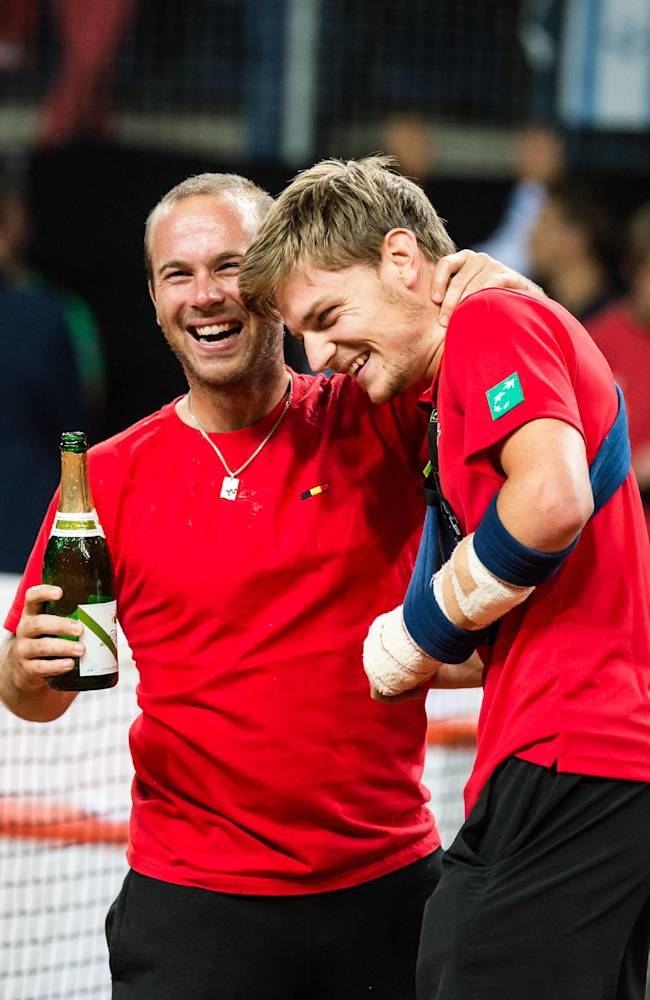 Belgium's David Goffin, right, celebrates with teammate Olivier Rochus after beating Israel during the World Group play-off Davis Cup tennis match in Antwerp, Belgium, on Sunday, Sept. 15, 2013. Belgium won 3-2