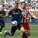 IMAGE DISTRIBUTED FOR GUINNESS INTERNATIONAL CHAMPIONS CUP Manchester City forward Edin Dzeko, left, and Olympiacos' Kostas Manolas are seen battling for the ball during the first half of 2014 Guinness International Champions Cup, on Saturday, Aug. 2, 201