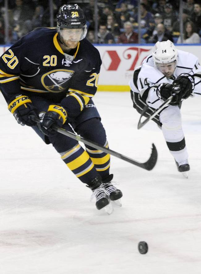 Buffalo Sabres defenseman Henrik Tallinder (20), of Sweden, battles for the puck with Los Angeles Kings right winger Justin Williams during the second period of an NHL hockey game in Buffalo, N.Y., Tuesday, Nov. 12, 2013