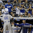 Los Angeles Dodgers' Yasiel Puig (66) is greeted by manager Don Mattingly, right, after Puig hit a home run during the seventh inning of the second baseball game of a doubleheader against the New York Yankees on Wednesday, June 19, 2013, in New York. (AP Photo/Frank Franklin II)