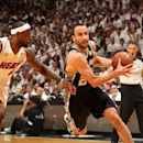 MIAMI, FL - JUNE 20: Manu Ginobili #20 of the San Antonio Spurs drives against LeBron James #6 of the Miami Heat during Game Seven of the 2013 NBA Finals on June 20, 2013 at American Airlines Arena in Miami, Florida. (Photo by Issac Baldizon/NBAE via Getty Images)