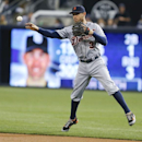 Detroit Tigers second baseman Ian Kinsler makes the off balance throw to first after snaring a grounder in the hole hit by San Diego Padres' Seth Smith during the first inning of a baseball game Friday, April 11, 2014, in San Diego. Kinsler got the out at