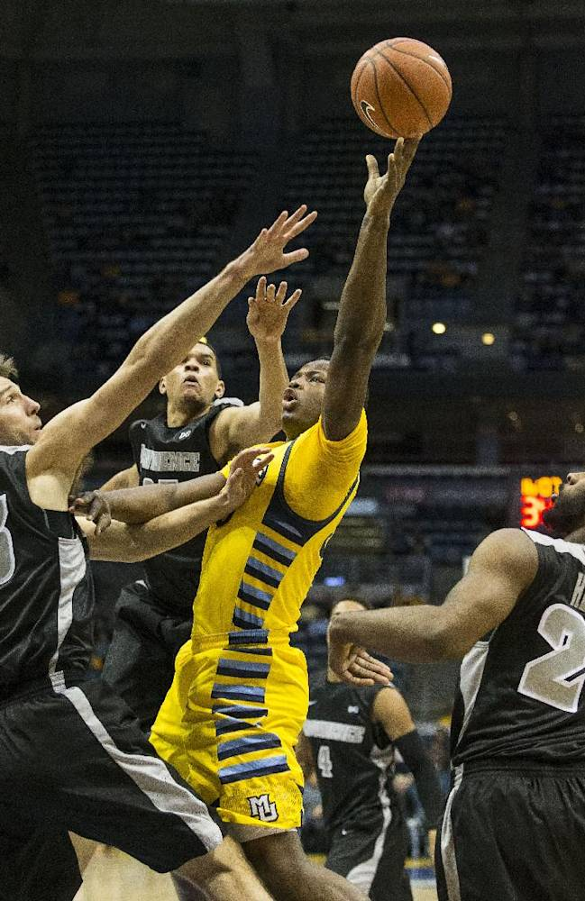 Marquette's Juan Anderson, center, drives past Providence's Carson Desrosiers, left, and LaDontae Henton during the first half of an NCAA college basketball game on Thursday, Jan. 30, 2014, in Milwaukee