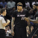 Miami Heat forward Chris Andersen, center, argues with official Kevin Scott, left, as Heat forward LeBron James looks on during the second half of an NBA basketball game against the San Antonio Spurs, Thursday, March 6, 2014, in San Antonio. San Antonio won 111-87. (AP Photo/Darren Abate)