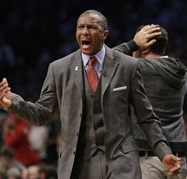 Toronto Raptors coach Dwane Casey reacts to a call during the second half of Game 3 of an NBA basketball first-round playoff series against the Brooklyn Nets on Friday, April 25, 2014, in New York. The Nets won 102-98