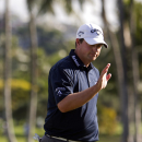 Brian Stuard waves to the gallery on the 18th green during the second round of the Sony Open golf tournament, Friday, Jan. 10, 2014, in Honolulu. (AP Photo/Marco Garcia)