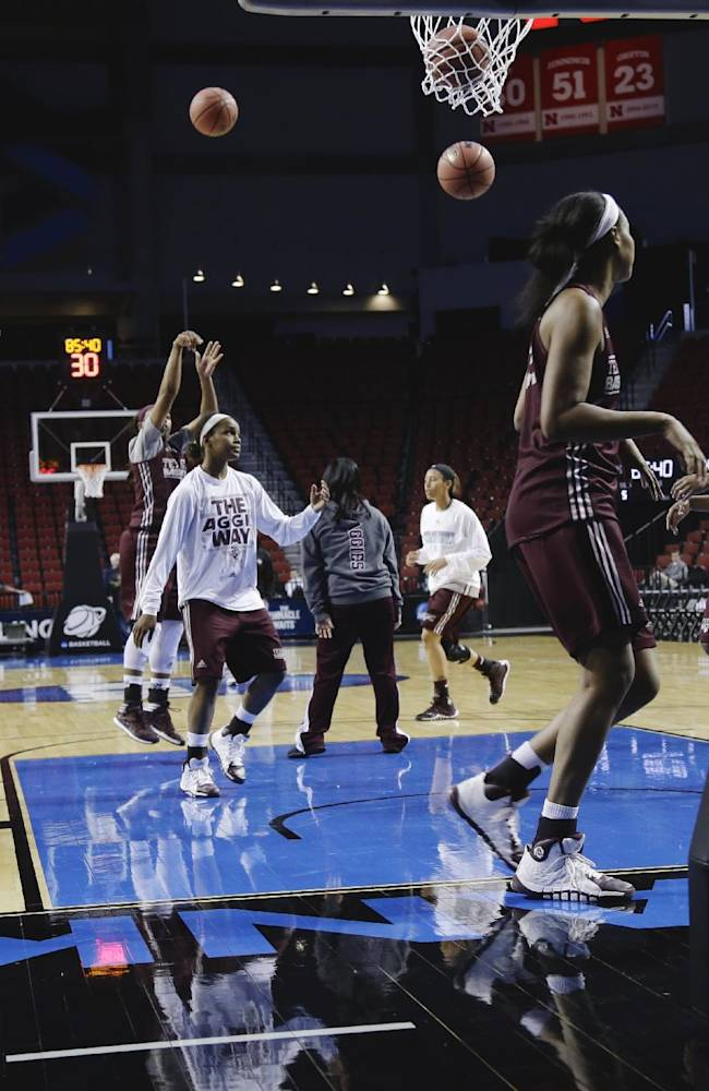 Texas A&M players go through drills during NCAA college basketball practice in Lincoln, Neb., Friday, March 28, 2014. Texas A&M will play DePaul in an NCAA Lincoln Regional women's semifinal basketball game on Saturday