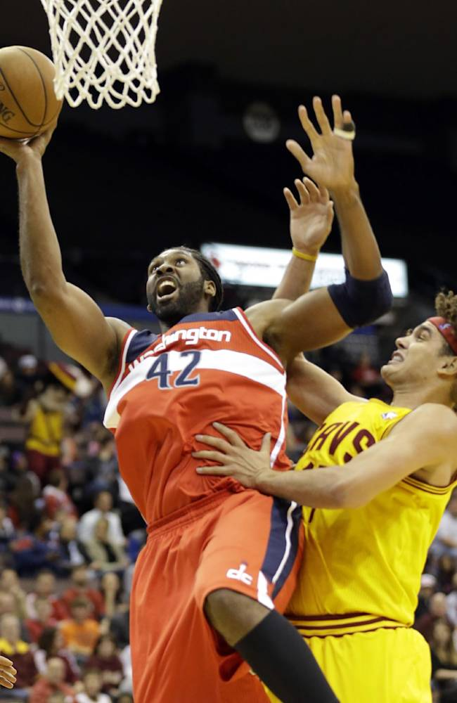 Washington Wizards center Nene (42), of Brazil, shoots against Cleveland Cavaliers forward Anderson Varejao, also of Brazil, in the first half of an NBA preseason basketball game on Wednesday, Oct. 23, 2013, in Cincinnati