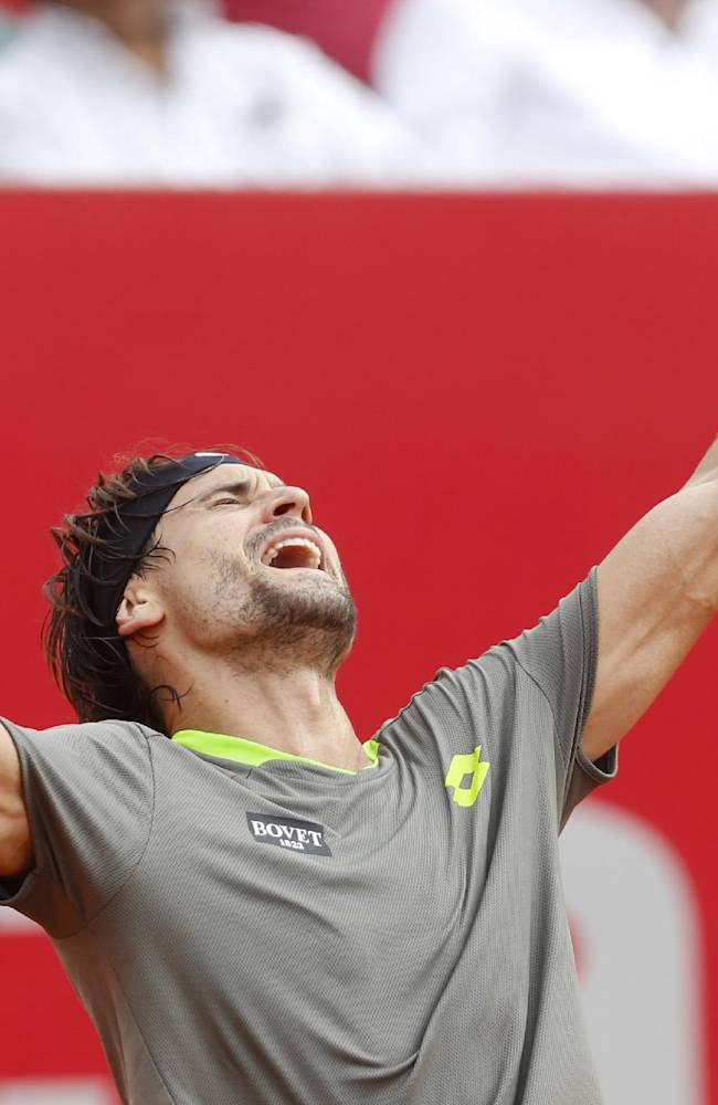 David Ferrer of Spain celebrates after defeating Fabio Fognini of Italy in the final match of the Buenos Aires' Copa Claro tennis Open in Buenos Aires, Argentina,  Sunday, Feb. 16, 2014. Ferrer won 6-4, 6-3