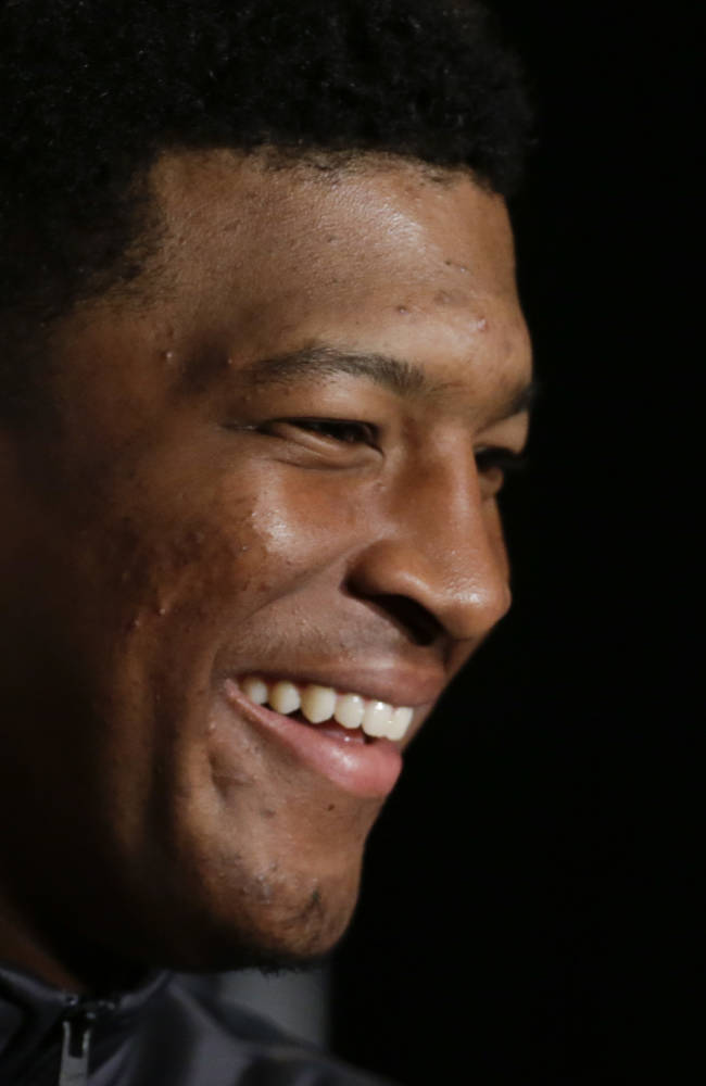 Florida State quarterback Jameis Winston answers questions during a news conference on Friday, Jan. 3, 2014 in Newport Beach, Calif. Florida State is scheduled to play Auburn on Monday, in the BCS national championship NCAA college football game