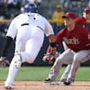 Arizona Diamondbacks second baseman Aaron Hill, back, waits for throw as Colorado Rockies' Carlos Gonzalez steals second base in the ninth inning of the Diamondbacks' 5-3 victory in a baseball game in Denver on Sunday, April 6, 2014 The Associated Press
