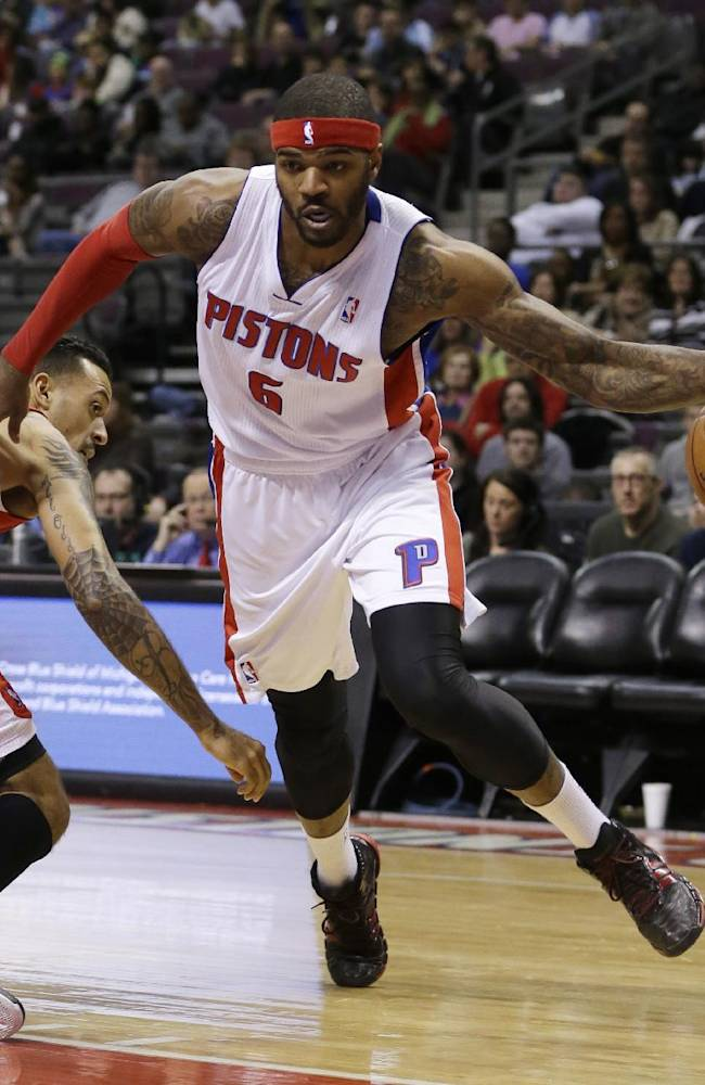 Detroit Pistons forward Josh Smith (6) drives around Los Angeles Clippers forward Matt Barnes (22) during the first half of an NBA basketball game in Auburn Hills, Mich., Monday, Jan. 20, 2014