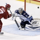 Phoenix Coyotes' Radim Vrbata (17), of the Czech Republic, gets his shot knocked away by Winnipeg Jets' Ondrej Pavelec (31), of the Czech Republic, during the shootout of an NHL hockey game, Tuesday, April 1, 2014, in Glendale, Ariz. The Jets defeated the