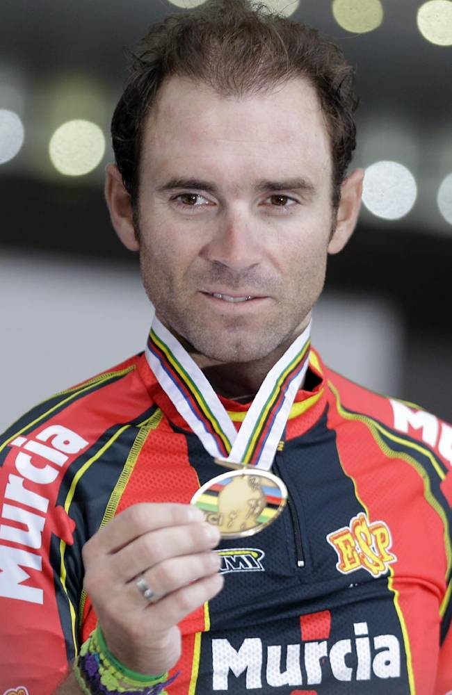 Bronze medalist Alejandro Valverde Belmonte, of Spain, shows his medal during the podium ceremony for the men's elite road race event, at the road cycling world championships, in Florence, Italy, Sunday, Sept. 29, 2013