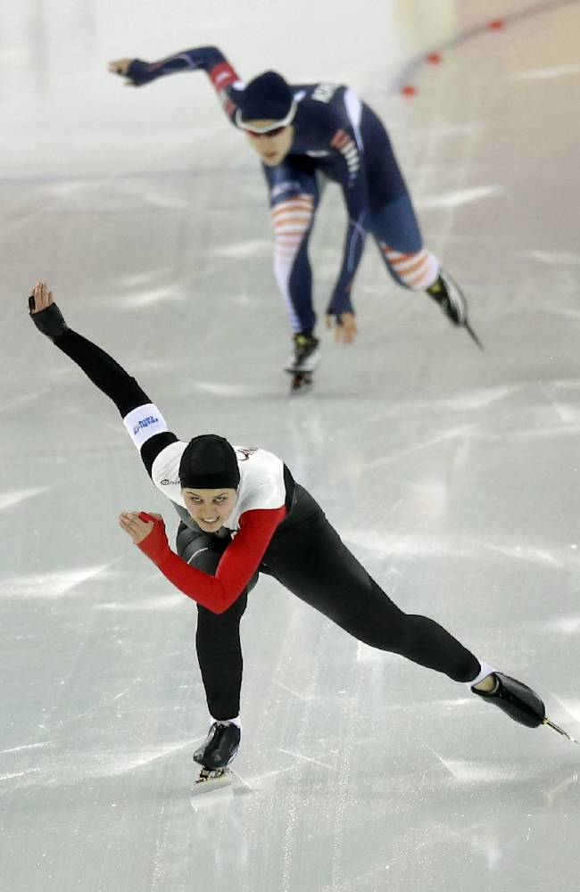 Canada's Marsha Hudey, foreground, and South Korea's Kim Hyun-yung compete in the first heat of the women's 500-meter speedskating race at the Adler Arena Skating Center during the 2014 Winter Olympics, Tuesday, Feb. 11, 2014, in Sochi, Russia