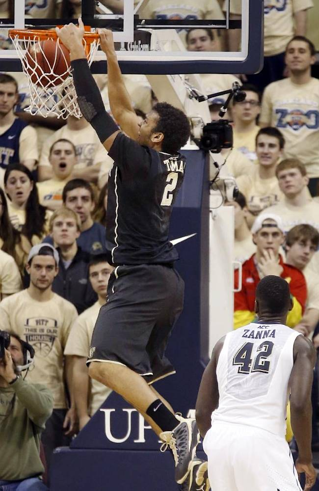Wake Forest's Devin Thomas (2) dunks after getting behind Pittsburgh's Talib Zanna (42) in the first half of an NCAA college basketball game on Saturday, Jan. 11, 2014, in Pittsburgh