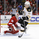 Boston Bruins right wing Reilly Smith (18) celebrates his shootout goal against Detroit Red Wings goalie Jimmy Howard (35) in an NHL hockey game in Detroit, Wednesday, Oct. 15, 2014. Boston won 3-2 in the shootout The Associated Press