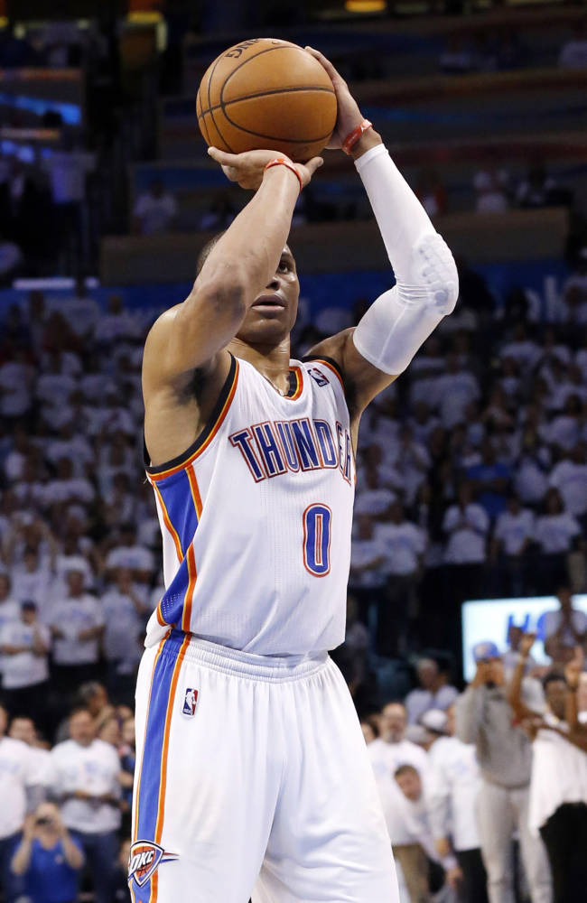 Oklahoma City Thunder guard Russell Westbrook shoots his game-winning foul shot in the fourth quarter of Game 5 of the Western Conference semifinal NBA basketball playoff series against the Los Angeles Clippers in Oklahoma City, Tuesday, May 13, 2014. Oklahoma City won 105-104. (AP Photo)