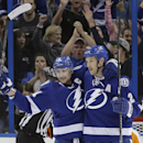 Tampa Bay Lightning defenseman Eric Brewer (2) celebrates with center Steven Stamkos (91) after scoring against the Philadelphia Flyers during the third period of an NHL hockey game Thursday, April 10, 2014, in Tampa, Fla. The Lightning won 4-2 The Associ