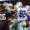 Dallas Cowboys tight end Jason Witten (82) celebrates his touchdown with teammates as Jacksonville Jaguars free safety Josh Evans (26) walks by during the first half of an NFL football game at Wembley Stadium, London, Sunday, Nov. 9, 2014 The Associated P