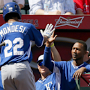 Kansas City Royals' Raul Mondesi (22) gets a high-five from teammate Jarrod Dyson, right, after Mondesi scored against the Los Angeles Angels during the first inning of a spring training baseball game Friday, March 21, 2014, in Tempe, Ariz The Associated