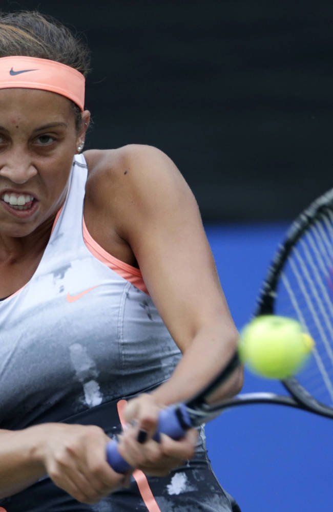 Madison Keys of U.S. returns the ball against Caria Suarez Navarro of Spain during their first round match of Pan Pacific Open tennis tournament in Tokyo, Monday, Sept. 23, 2013