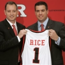 FILE - In this May 6, 2010, file photo, Rutgers athletic director Tim Pernetti, right, presents Mike Rice with a jersey after Rice was introduced as the school's men's basketball coach during a news conference in Piscataway, N.J. The airing Tuesday, April 2, 2013, of a videotape of Rice using gay slurs, shoving and grabbing his players and throwing balls at them in practice over the past three seasons has Pernetti reconsidering his decision not to fire the coach. Pernetti was given a copy of the video in late November by a disgruntled former employee, and he suspended Rice for three games, fined him $50,000 and made him undergo anger management classes for inappropriate behavior after investigating it. (AP Photo/Rich Schultz, File)