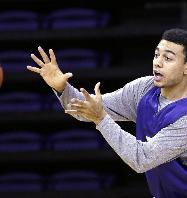Washington's Nigel Williams-Goss reaches for a pass during basketball practice Tuesday, Oct. 8, 2013, in Seattle