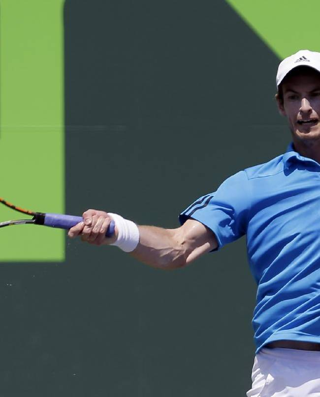 Andy Murray, of Great Britain, returns to Feliciano Lopez, of Spain, at the Sony Open tennis tournament in Key Biscayne, Fla., Sunday, March 23, 2014
