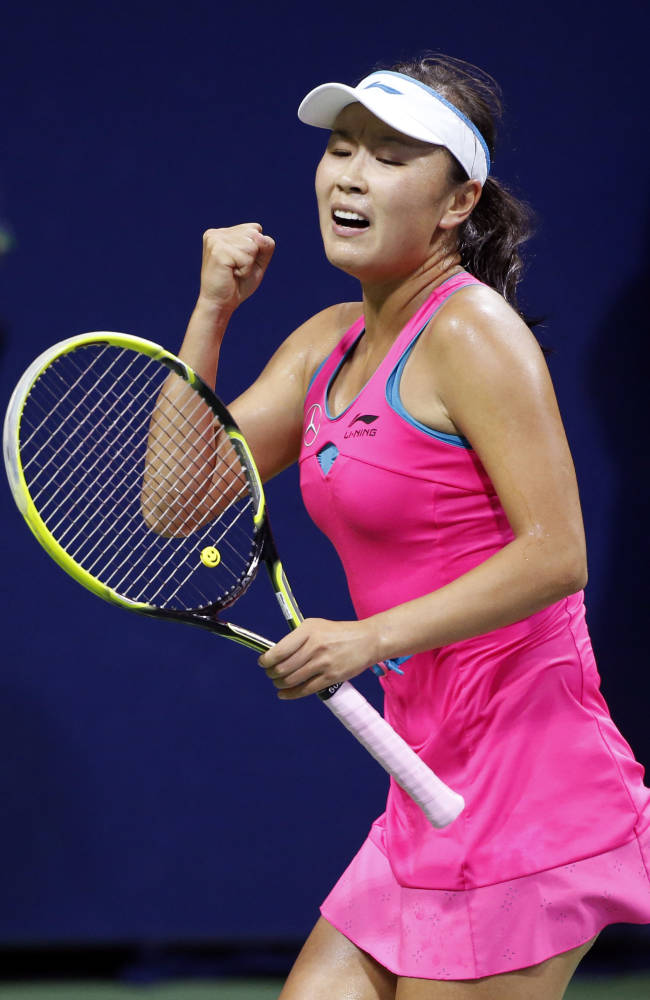 Shuai Peng, of China, reacts after winning a point against Lucie Safarova, of Czech Republic, during the fourth round of the U.S. Open tennis tournament Sunday, Aug. 31, 2014, in New York