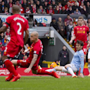 Manchester City's David Silva, bottom right, scores his first goal against Liverpool during their English Premier League soccer match at Anfield Stadium, Liverpool, England, Sunday April 13, 2014