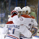 Montreal Canadiens left wing Thomas Vanek (20), of Austria, celebrates with teammates Max Pacioretty (67) and David Desharnais (51) after scoring against the Tampa Bay Lightning during the third period of Game 1 of a first-round NHL hockey playoff series