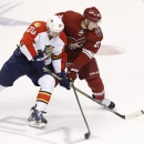 Florida Panthers' Sean Bergenheim (20), of Finland, battles Arizona Coyotes' Lauri Korpikoski, right, also of Finland, for the puck during the first period of an NHL hockey game Saturday, Oct. 25, 2014, in Glendale, Ariz The Associated Press