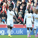 Swansea City's Wilfried Bony, left, celebrates scoring against Stoke City during their English Premier League soccer match at the Britannia Stadium, Stoke, England, Sunday, Oct. 19, 2014