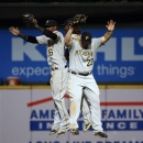 Pittsburgh Pirates' Starling Marte (6), Travis Snider (23) and Andrew McCutchen celebrate a baseball game win over the Milwaukee Brewers, Saturday, May 25, 2013, in Milwaukee. The Pirates won 5-2. (AP Photo/Morry Gash)
