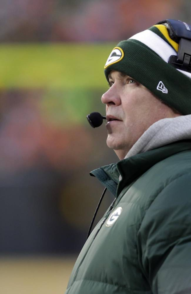 Green Bay Packers head coach Mike McCarthy watches the monitor during the first half of an NFL wild-card playoff football game against the San Francisco 49ers, Sunday, Jan. 5, 2014, in Green Bay, Wis