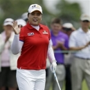 Inbee Park, of South Korea, waves to the crowd before hitting a tee shot on the first hole during the third round of the U.S. Women's Open golf tournament at the Sebonack Golf Club Saturday, June 29, 2013, in Southampton, N.Y. (AP Photo/Frank Franklin II)