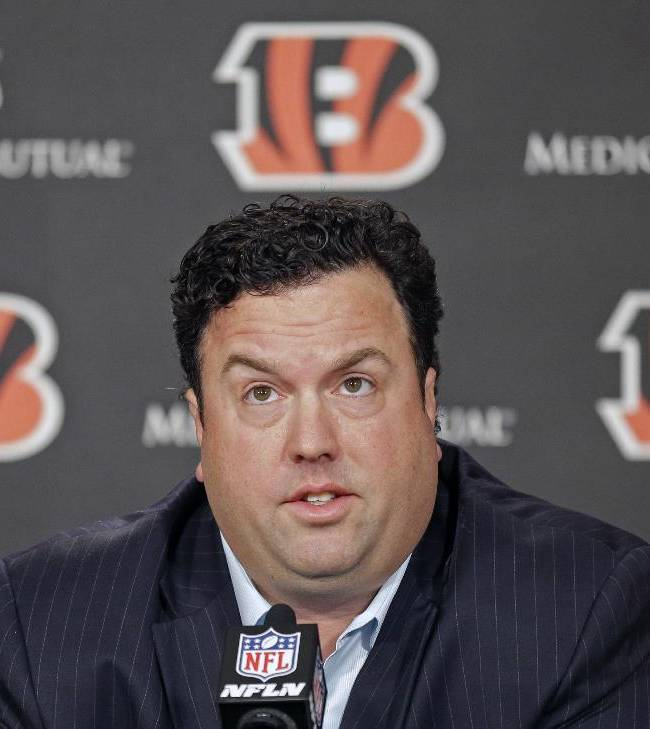 Paul Guenther answers questions at a news conference, Thursday, Jan. 16, 2014, in Cincinnati, after Guenther was named the new defensive coordinator for the NFL football Cincinnati Bengals. Guenther, who had been linebackers coach for the Bengals, replaces Mike Zimmer who took the head coaching job in Minnesota
