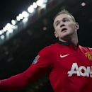 Manchester United's Wayne Rooney waits to take a corner during his team's English Premier League soccer match against Everton at Old Trafford Stadium, Manchester, England, Wednesday Dec. 4, 2013