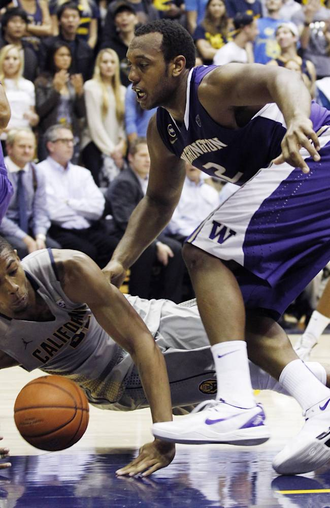 California's Richard Solomon falls down next to Washington's Perris Blackwell while lunging for a loose ball during the second half of an NCAA college basketball game, Wednesday, Jan. 15, 2014, in Berkeley, Calif
