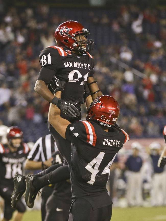 San Diego State wide receiver Eric Judge is lifted by Adam Roberts after his thirteen yard touchdown reception in overtime against Nevada that proved to be the winning score in San Diego State's 51-44 victory in a NCAA college football game  Friday, Oct. 4, 2013, in San Diego