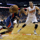 Atlanta Hawks' Jeff Teague (0) drives against Phoenix Suns' Shavlik Randolph (43) during the first half of an NBA basketball game, Sunday, March 2, 2014, in Phoenix The Associated Press