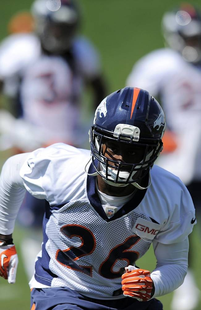 Denver Broncos free safety Rahim Moore runs a drill during NFL football practice in Englewood, Colo., on Monday, Aug. 25, 2014