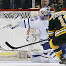 Toronto Maple Leafs' James Reimer (34) deflects a shot by Boston Bruins' Gregory Campbell (11) in the third period of an NHL hockey game in Boston, Saturday, Nov. 9, 2013. The Bruins won 3-1 The Associated Press