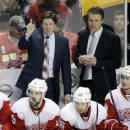 Detroit Red Wings head coach Mike Babcock, top left, directs his players in the second period of an NHL hockey game against the Nashville Predators Saturday, Feb. 28, 2015, in Nashville, Tenn. (AP Photo/Mark Humphrey)