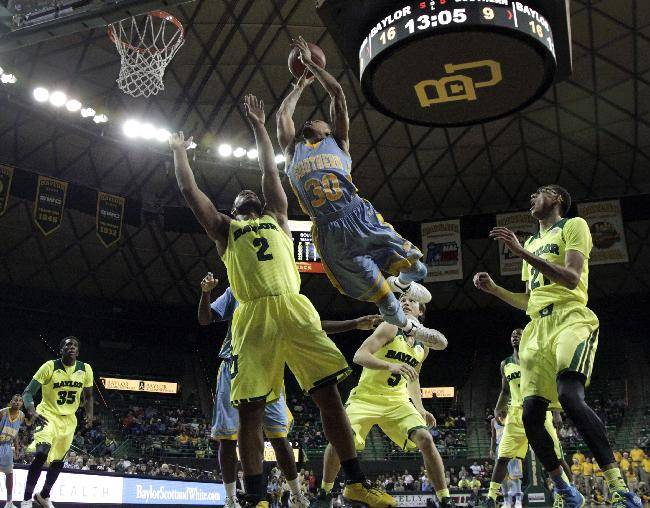 Southern forward Calvin Godfrey (20) extends upward for a shot over Baylor's Rico Gathers (2) as Taurean Prince (35) Brady Heslip (5) and Isaiah Austin, right, watch in the first half of an NCAA college basketball game, Sunday, Dec. 22, 2013, in Waco, Texas